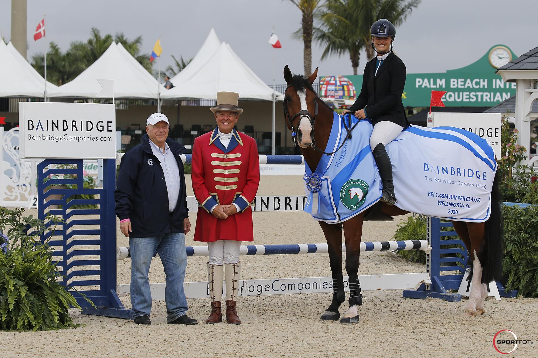 Kristen VanderVeen with Ringmaster Steve Rector and Richard Schechter, Chairman and CEO of Bainbridge Companies