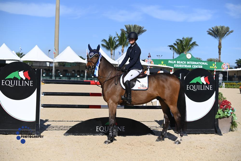 Rachel McMullen and Deavantus were victorious in the $2,500 Equiline High Junior/Amateur-Owner Jumper Classic. ©Anne Gittins Photography