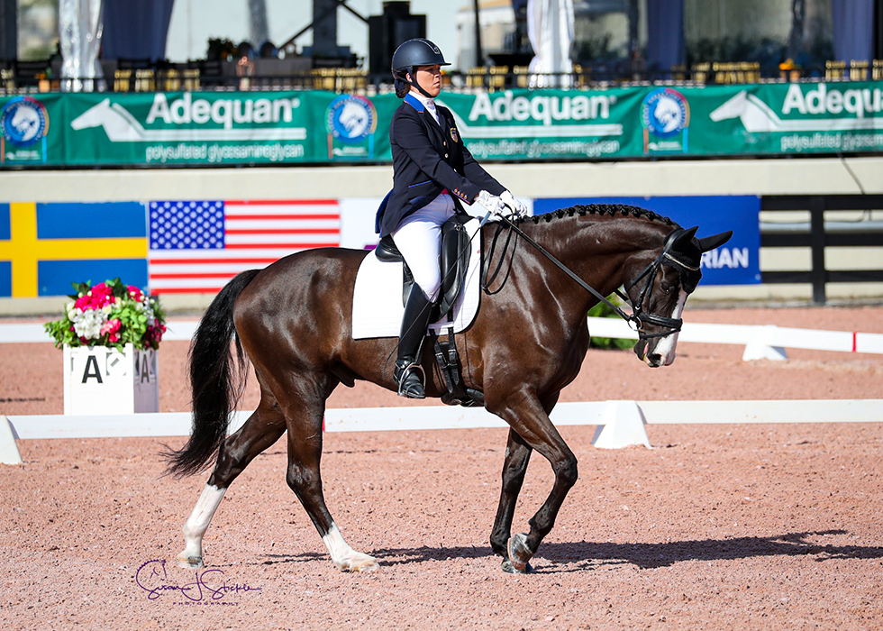 Roxanne Trunnell (USA) and Dolton take the Grade 1 class by storm, scoring over 81%.