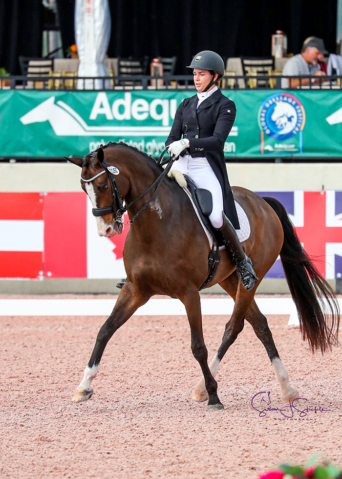 Anna Marek (USA) records her first win of the week, claiming the top spot in the FEI Intermediate I Freestyle CDI3* with 73.8% on Snoopy Sunday.