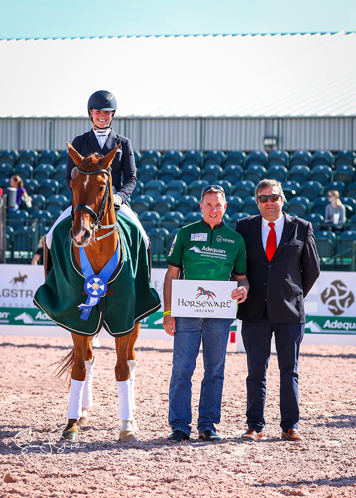 FEI Intermediate I CDI3* winner Beatrice Boucher (CAN) and Louxor De Lys in the prize-giving with Allyn Mann of Adequan® and judge Carlos Lopes. ©️Susan Stickle.