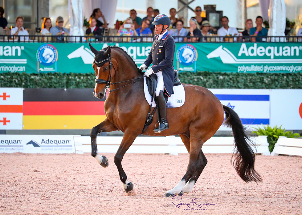 Steffen Peters and Suppenkasper score nines for both their canter pirouettes en route to a plus-76% grand prix victory in the qualifier for the Friday night freestyle. ©️Susan Stickle.